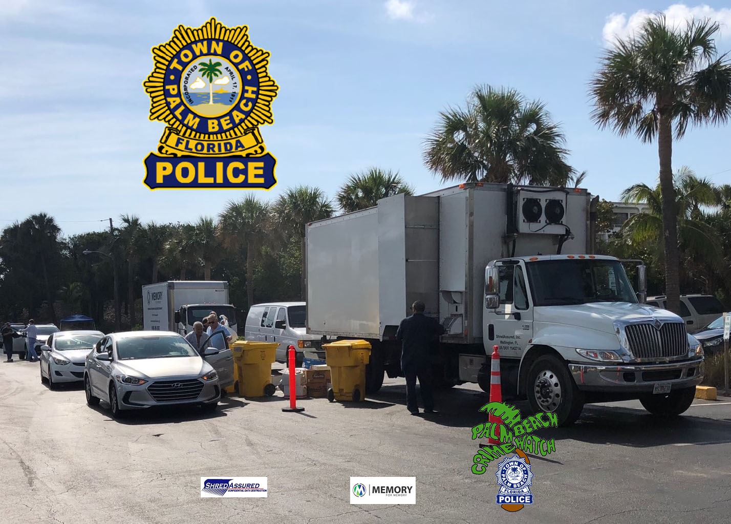 Shred Event pic two trucks with Badge and pics